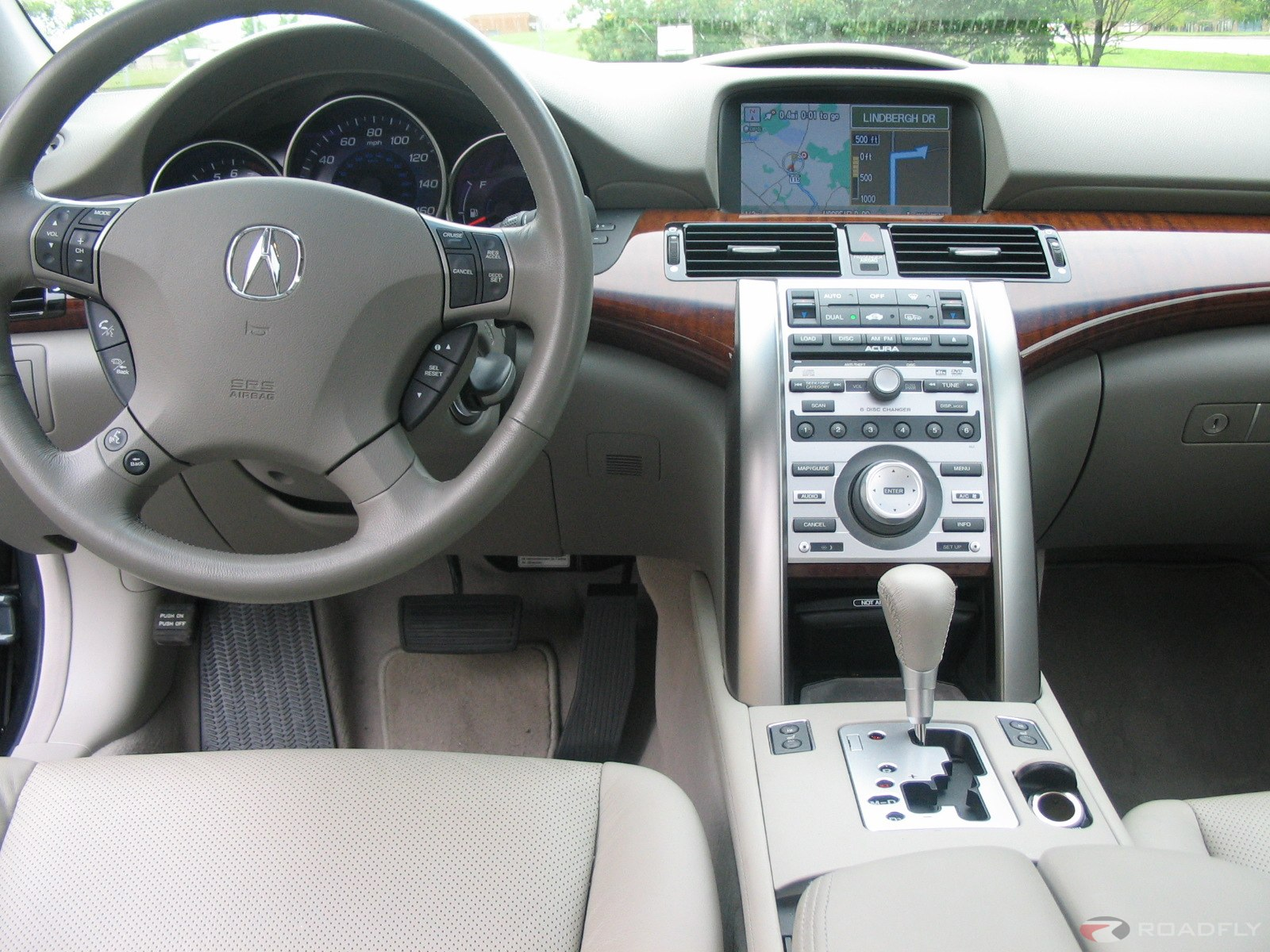 Beyond navigation, the Acura RL boasts abundant features and frills; most of them electronic and nearly all standard fare. Roll-up window shades in the rear ...